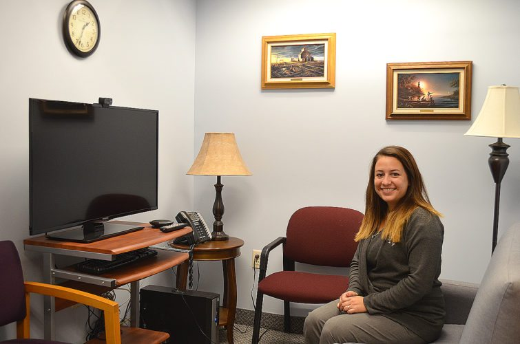 Staff photo by Connor Cummiskey Sioux Trail's Mental Health Center's newest outpatient therapist Elizabeth Quinby sits in the telemental health room where clients or therapists will be able to connect virtually for teleconferencing.