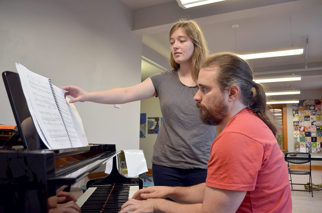 """Staff photo by Connor Cummiskey Molly Hennig (left) and Peter Michael von der Nahmer (right) rehearse the song """"It's a World of Repetition"""" at The Grand Center for Arts and Culture."""