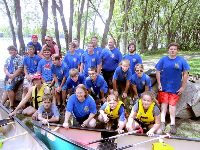 """In early August members of New Ulm Boy Scouts Troop 25 and some siblings plus adults went on a one day """"cheap thrills"""" trip to St. Cloud. They canoed the Mississippi, visited the dam, and spent hours jumping the rock cliffs in Quarry Park and Nature Preserve (below). They ended the day at a buffet restaurant. First Row: Left to right-Amy Johnson, Anton Leonard, Cindy Bode, Amanda Vogel, Meghan Leonard. 2nd Row: Parker Sunderman, Dylan Kotten, Brian Longtin, Joey Gag, Brock Carlson, Ethan Richter, Jacob Vogel. Keenan Davis, Patrick Leonard. 3rd Row: Chris Surprenant, David Bode, Ben Hubbard, Bennett Carlson, Isaac Davis, Joe Leonard, John Vogel, Steve Bode. Not pictured - Tom Henderson and Kara Carlson - Trip Leader."""