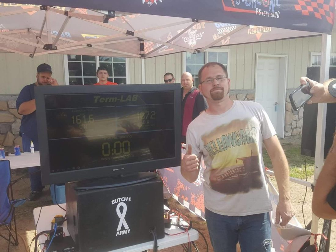 Dan Horner poses with the readout screen showing his record breaking score. Horner actually achieved a sound pressure level of 167.2 dB, but to receive the record, a vehicle must hit a certain level twice.