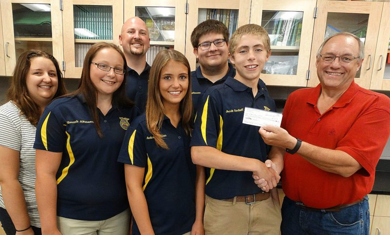 Brown County Farm Bureau along with Minnesota Farm Bureau Foundation and Schwartz Farms Inc. donated $350.00 to each FFA Chapter in the county - New Ulm, Sleepy Eye and Springfield. The money will be used for Agriculture Education purposes. Accepting the donation for New Ulm FFA are (l-r) Kelsy Brandt-FFA Advisor, Hannah Altmann-Vice President, Jeff Nelson-FFA Advisor, Audra Bastian-Treasurer, Zach Hoffmann-Reporter and Jacob Radloff-President from Greg Bartz-Brown County Farm Bureau President.