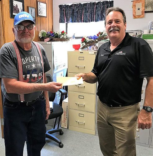Submitted photo Larrys Kilmer-left, Disabled American Veterans Senior Vice Commander for the New Ulm Chapter #15 delivers a check for $1500 to Dave Koester, Assistant Brown County Veterans Service Officer. The check is being sent help provide hurricane relief to Veterans in Houston, Texas. Others wishing to make donations to Houston Veterans may drop off the donation, or mail it to Brown County Veterans Service, PO Box 248, New Ulm, MN 56073.
