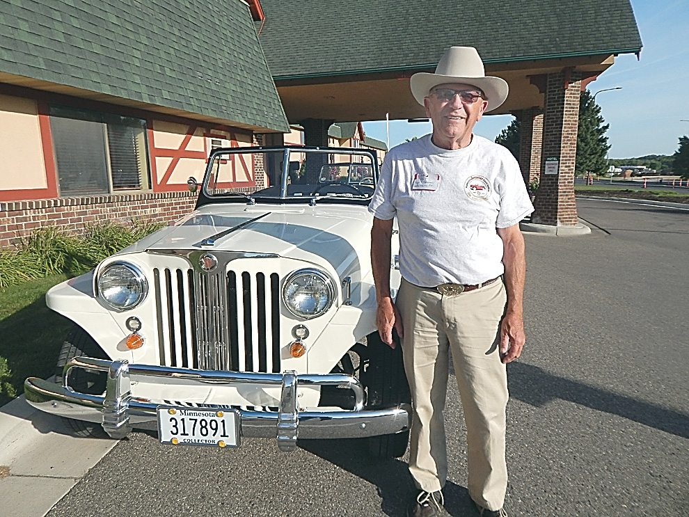 Staff photo by Fritz Busch Midstates Jeepster Association member Ralph Machemehl of Lester Prairie poses with his Jeepster at the Best Western Plus in New Ulm Thursday. Machemehl and his wife Donna are hosts for the Midstates Jeepster Association that is spending the weekend in New Ulm.