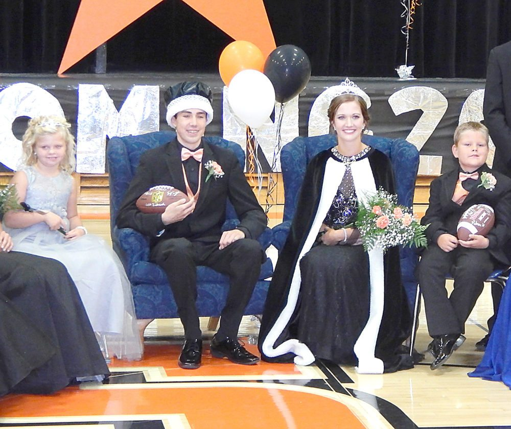 Staff photo by Fritz Busch  The Sleepy Eye Homecoming Coronation Monday included far left, Junior Attendants Jace Schauman and Jacob Fulmer, far right; and King Zach Haala and Queen Brianna Polesky. The Indians host Adrian on the football field at 7 p.m. Friday.