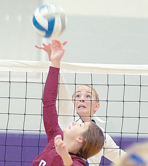 Staff photo by Steve Muscatello New Ulm's Ashlyn Donner spikes the ball past Andrea Westcott of Fairmont Tuesday at New Ulm High School. For more photos of this event go to cu.nujournal.com
