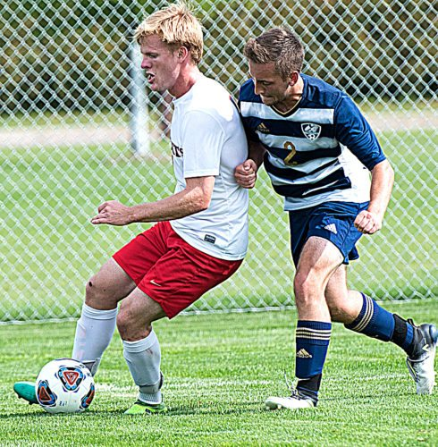 Photo  courtesy of MLC/Michael Wu Martin Luther College's Nathan Graumann escapes a North Central defender in Tuesday's 2-0 victory at MLC.