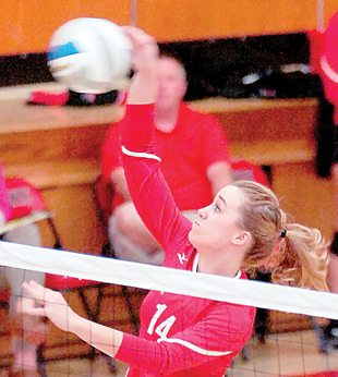 Staff photo by Steve Muscatello Martin Luther College's Rylee Weisensel spikes the ball during the Knights' match against St. Olaf Monday at MLC in New Ulm. For more photos of this event go to cu.nujournal.com