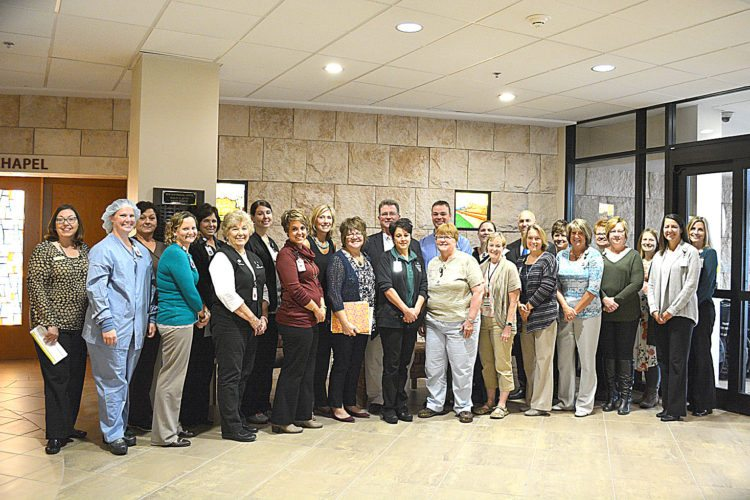 Staff photo by Connor Cummiskey  Staff members of the New Ulm Medical Center (NUMC) and representatives of the New Ulm Chamber of Commerce gathered at the NUMC lobby Monday morning to hear the Chamber's announcement of NUMC as the 2017 Business of the Year.