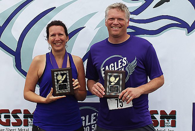 Jess Wiborg and Jason Rewitzer are this year's Alumni Award winners for the Eagles 5000.