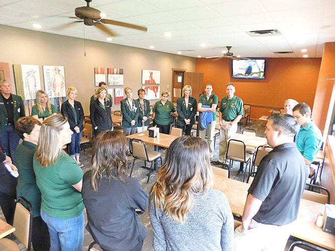 Staff photo by Clay Schuldt  Manager Kevin Siefkes (foreground, right) shows off the newly re-opened Pizza Ranch Thursday during a ribbon cutting.