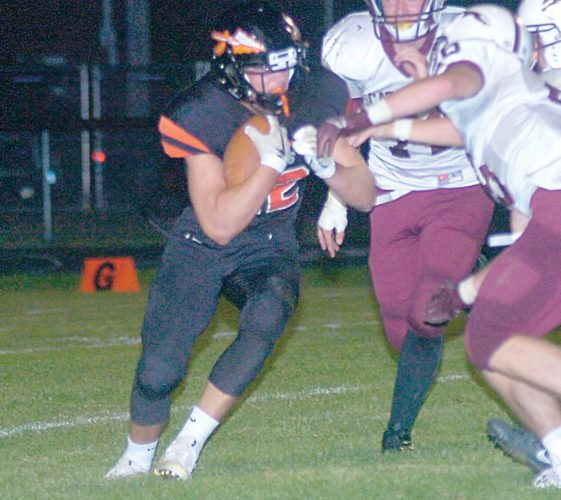 File photo by Steve Muscatello Sleepy Eye's Landon Strong carries the ball during a recent game in Sleepy Eye.
