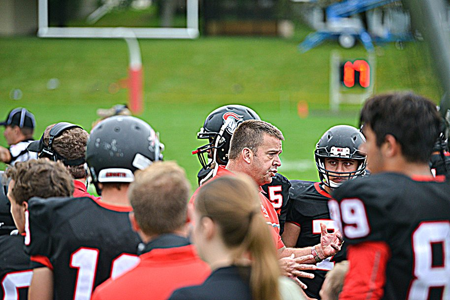 Photo courtesty of MLC Athletic Department Martin Luther College third-year coach Mark Stein (center, red shirt) talks to his players during a game. Stein has the Knights off to a quick start and the program is seeing a rise in numbers. Stein went 2-18 in his first two seasons but is hoping that he can lead the program to better days ahead.