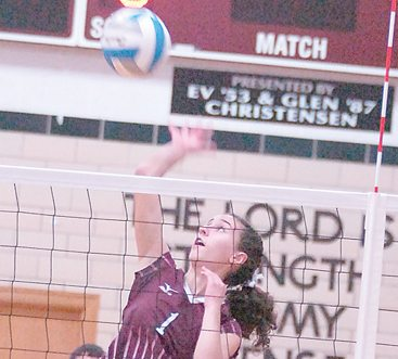 File photo by Steve Muscatello New Ulm Cathedral's Sarah Mohr spikes the ball during a recent match at CHS.