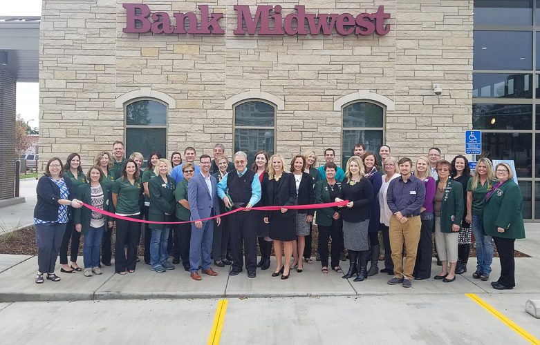 The New Ulm Chamber of Commerce Willkommen Committee last week held a ribbon-cutting with Mayor Robert Beussman to officially celebrate the opening of the new Bank Midwest building and to thank Bank Midwest for their investment in the New Ulm community.  The new building, located at 525 Center Street, is 6500 square feet while their old location was just 1900 square feet. Bank President Shannon Hillesheim has already hired two employees with the expanded space, bringing their staff count to 13.  The new building includes a break room, a conference room, and a fitness workspace that is Heart of New Ulm approved. The bank will be holding a public open house on Friday, from 11 a.m. to 2 p.m.