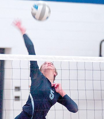 File photo by Steve Muscatello Sophomore Mara Weisensel spikes the ball during a recent match at Minnesota Valley Lutheran High School.