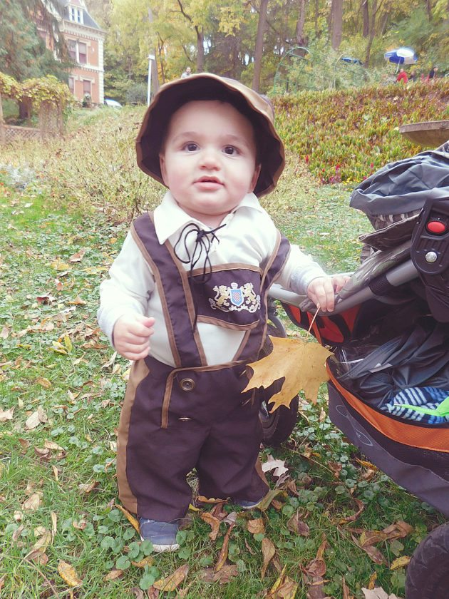 Staff photo by Clay Schuldt Leland Johnson, 14 months, of St. Paul was a hit at the Schell's Brewery with his lederhosen. His mother, Megan Johnson, promised to buy him a new set as he grows up. Leland's favorite part of Oktoberfest was playing with the leaves.