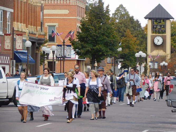 The Oktoberfest Promenade Parade was lead by Bank Midwest staff. The parade route began at the Glockenspiel and ended on Center Street located next to the new Bank Midwest building.