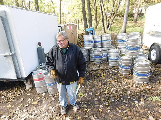 "Staff photo by Clay Schuldt  Ted Marti, head of August Schell's Brewing Company, counts the number of empty kegs the day after the Oktoberfest celebration held on site. Marti wanted to get a firsthand count of the expired kegs to make sure the mix was right for future product runs. This year's Oktoberfest had lower numbers than in 2016. Marti estimated 1,000 less people visited the brewery, but he is not disappointed with the turnout. ""It was still a wonderful celebration,"" he said."