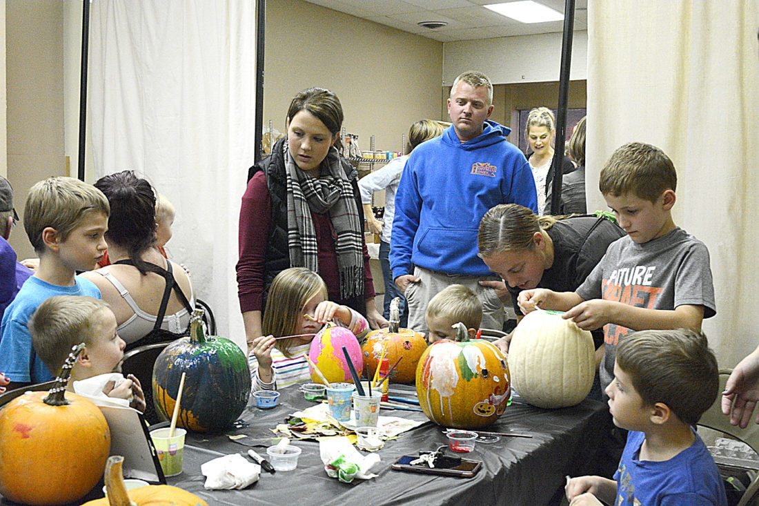 Staff photo by Connor Cummiskey  Parents brought their children to the New Ulm Community Market & Cooperative Thursday evening to spend some of the Minnesota Educator Academy (MEA) weekend celebrating the season by painting pumpkins.
