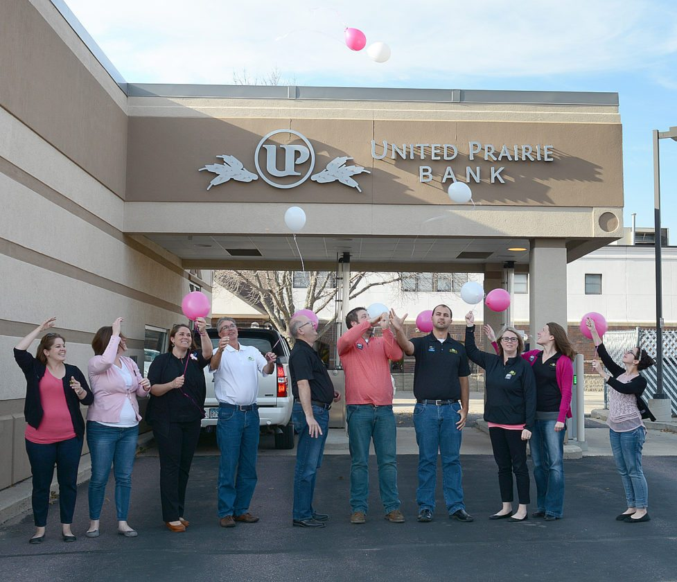 "United Prairie Bank team shows their support for Breast Cancer Awareness month Friday by releasing pink and white balloons in memory of those who have lost their battle with breast cancer and to ""show support to those currently fighting a courageous battle,"" the bank said. ""For the fourth quarter, the United Prairie Bank team wil be raising donations through their Denim 4 Dollars program where employees pay to wear jeans on Friday. The money will then be donated to help with breast cancer research."" Pictured from left to right: Julie Wilson, Becky Hulke, Jessica Durand, Tim Schultz, Mark Petersen, Alex Arends, Luke Northagen, Cherie Furth, Kari Steele and Jennifer Konakowitz. Not pictured: Katie Nosbush and Susannah Setterholm."