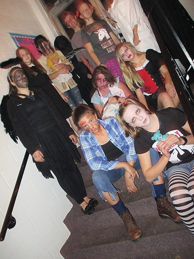 File Photo The Middle School Youth Council and Students Performing On Tough Situations (SPOTS) volunteers pose after the 2016 Haunted House. Many of the same students have returned for the 2017 Haunted House.