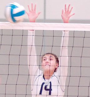 File photo by Steve Muscatello New Ulm's Rachel Hohensee attempts to block a spike during a recent match at New Ulm High School.