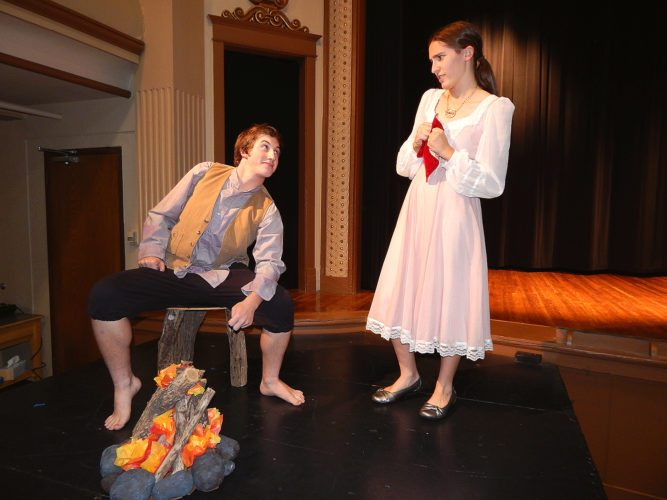 "Princess Whatshername (Samantha Guldan), suffering from amnesia, stumbles upon Rumpelstiltskin (Noah Thompson) in the Misty Forest in the New Ulm Area Catholic Schools production of ""Princess Whatshername."""