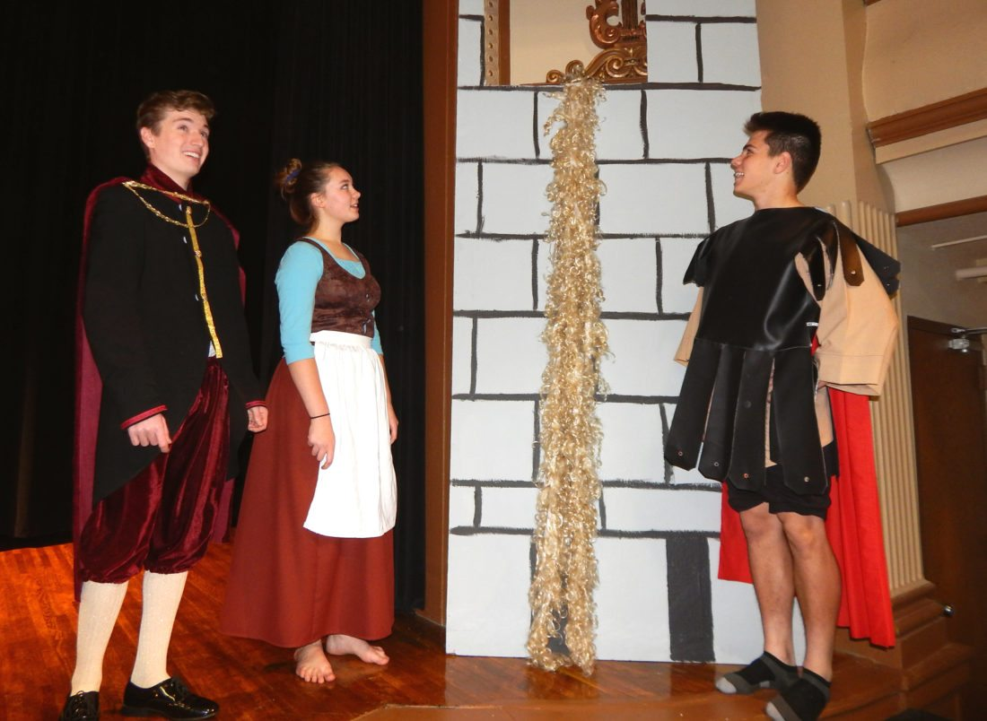 From left, Prince Reveille (Josh Dummer), Cinderella (Emma Henle) and Prince Hercules (Tony Geiger) wait outside Rapunzel's tower for Rapunzel to follow her hair through the window.