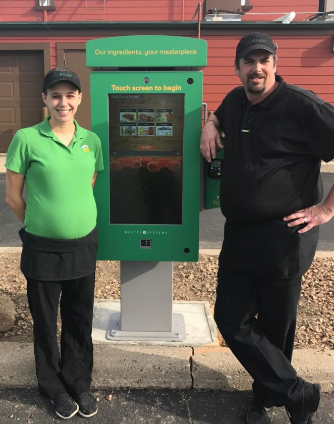 Submitted photo  Subway on South Broadway owner Amanda Marks, left, and store manager Eric Wendt stand near the new touch screen where drivers can order via touch screen or talk with an employee.