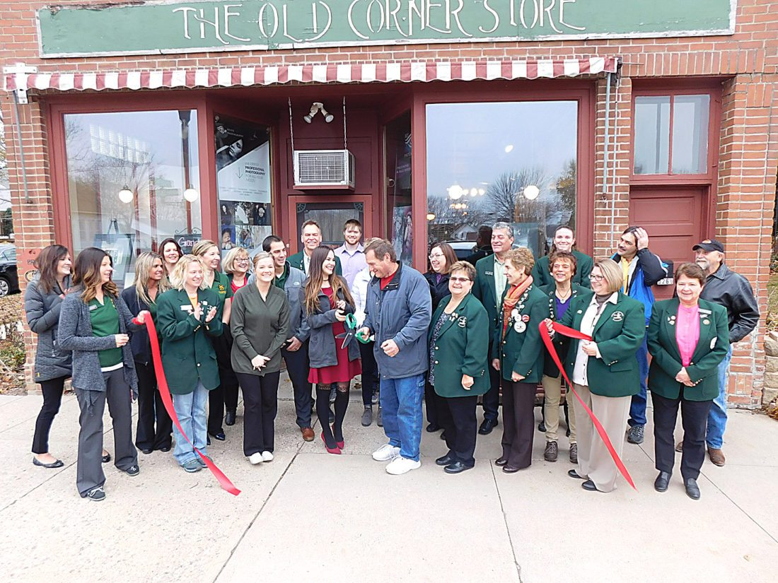 """Staff photo by Clay Schuldt  The Willkommen Committee of the New Ulm Area Chamber of Commerce on Thursday stopped by My Eye Photography to celebrate the new business with a ribbon-cutting, with City Councilor Dave Christian (front, center right). Shamara Hornick (front, center left) opened the photography studio at 526 S. Minnesota St. in the Old Corner Store building a few months ago. She grew up in New Ulm and graduated from Ridgewater College in Willmar with a degree in Professional Photography. She came back to New Ulm after college because, she says, she felt """"this is my home."""" She has been a full-time photographer for the past year, shooting on location, but is looking forward to having a studio for indoor photos, especially during the winter months."""