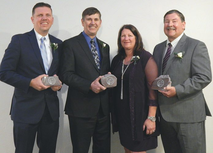 Staff photo by Connor Cummiskey The three winners of the Minnesota Valley Lutheran High School's 2017 Spirit of MVL award line up after being introduced during a recognition reception. Pictured left to right: Jon Enter, Perry Meyer, Vivian Smith and Mark Smith.