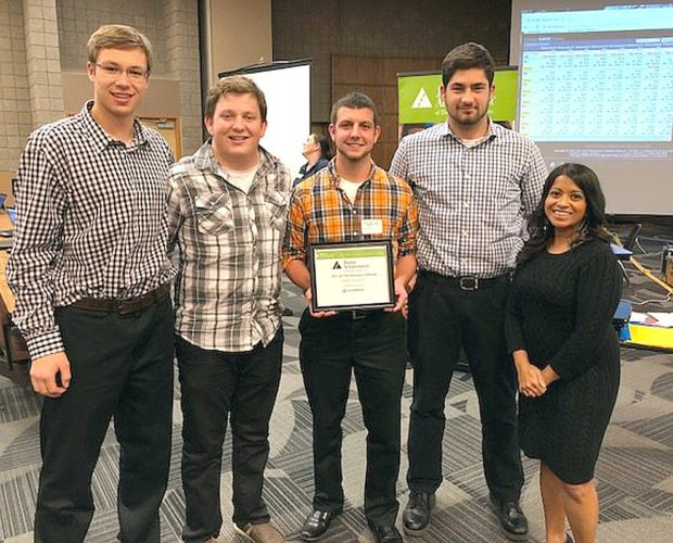 Submitted photo New Ulm High School's 1st place JA Titan team is (l to r) Alex Portner, Tyler Walls, Tyler Roufs and Joe Fortwengler, pictured with Miranda Honnette- Consolidated Communications