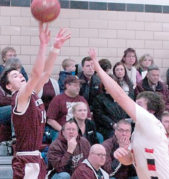 Staff photo by Steve Muscatello New Ulm Cathedral's James Gillis takes a shot over a St. Clair defender during the first half Thursday at CHS. For more photos of this event go to cu.nujournal.com