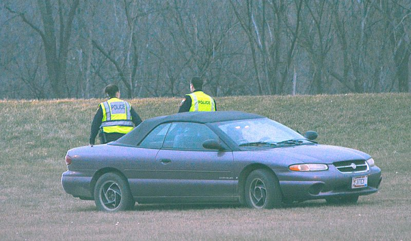 Staff photo by Connor Cummiskey  A sedan left the roadway on Highway 15 coming into New Ulm near the 7th North Street bridge just before 5 p.m. Friday. The vehicle came to a rest in a depression between Hwy 15 and the Front Street exit where it remained, appearing mostly unharmed, until it was loaded onto a flatbed and taken away.