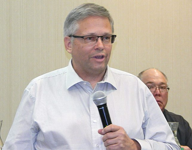 Staff photo by Fritz Busch Craig Haugaard, Grain Vice President at Sunrise Cooperative, Fremont, Ohio, talks about some of the finer points of commodity trading at the 55th Annual Minnesota NFO State Convention at the Best Western Conference Center, Saturday.