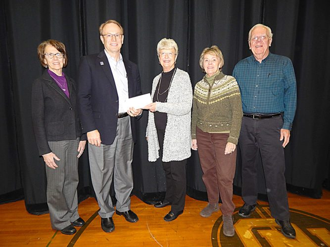 Staff photo by Fritz Busch  NU-Telecom donates $15,000 to the State Street Theater Capital Campaign Dec. 5. NU-Telecom's donation was matched by a $1,250 donation from CoBank through its Sharing Success Program. From left, NU-Telecom Chief Operating Officer Barb Bornhoft and Chief Executive Officer Bill Otis, State Street Theater Capital Campaign Coordinator Mary Ellen Domeier and board chairwoman Judy Sellner and campaign cabinet member Bob Schirlinger. The donations put the capital campaign past $201,000.