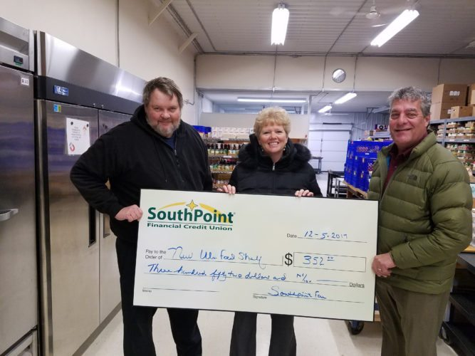 Submitted photo  From left, Brad Kirk, executive director of the New Ulm Area Food Shelf, Tammy Steffl, SouthPoint New Ulm service manager, and Brian Serbus SouthPoint New Ulm branch president.