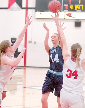 Staff photo by Steve Muscatello Minnesota Valley Lutheran's Sarah Dinse takes a shot between a pair of St. Croix Lutheran defenders during the first half Friday at Martin Luther College in New Ulm.  For more photos of this event go to cu.nujournal.com