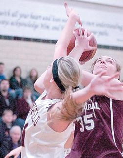 Staff photo by Steve Muscatello New Ulm Cathedral's Becca Schwarz (35) tries to gets a shot off despite close defensive play by Springfield's Mikayla Parker during the first half Friday at CHS. For more photos of this event go to cu.nujournal.com