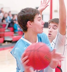 Staff photo by Steve Muscatello Minnesota Valley Lutheran's Jace Marotz looks to pass the ball past a St. Croix Lutheran defender. For more photos of this event go to cu.nujournal.com