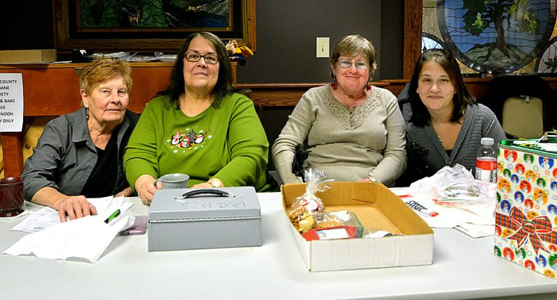 Staff photo by Connor Cummiskey  Volunteers oversaw purchase of donated goods to help fund the Brown County Humane Society. Pictured left to right: Lindy Carda, Julie Hibbard, Leona Costello and Nina Beise.