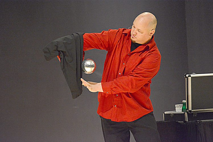 "Staff photo by Connor Cummiskey  Illusionist Adrian Van Vactor levitates a silver ball as part of the first act he ever performed during his show ""Magic of Christmas"" Sunday evening at the New Ulm Community Center."