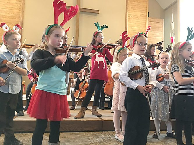 Staff photo  The youngest students perform during the New Ulm Suzuki School of Music holiday concert Sunday at Christ the King Lutheran Church in New Ulm.