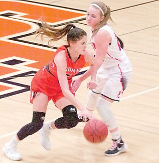 Staff photo by Steve Muscatello Sleepy Eye's Madi Heiderscheidt drives past a St Clair defender during the first half Monday in Sleepy Eye. For more photos of this event go to cu.nujournal.com