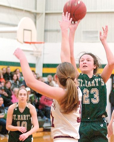 Staff photo by Steve Muscatello Sleepy Eye St. Mary's Madison Mathiowetz (23) takes a shot as Katelyn Hauth of Springfield defends on the play in the first half Monday at SESM. Looking on is the Knights' Mallory Helget (10). For more photos of this event go to cu.nujournal.com