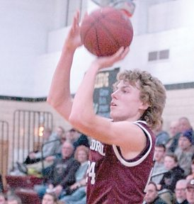 File photo by Steve Muscatello New Ulm Cathedral's Alex Hillesheim takes a jump shot during a recent game at CHS.