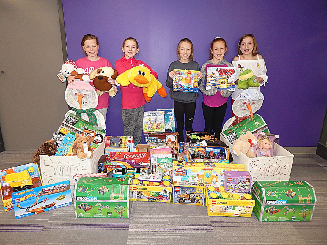 Staff photo by Fritz Busch  Jefferson Elementary School students pose with donations brought by students in grades 1-4. Fourth-graders, from left, Abby Havemeier, Sophie Lund, Brogan Thordson, Avarey Sellner and Brighton Muklebust.