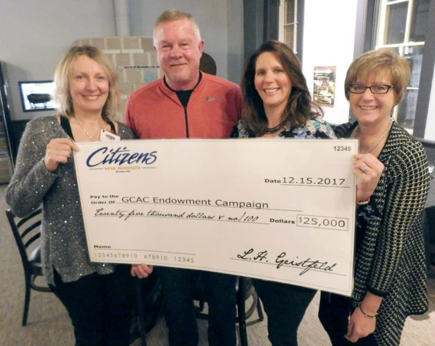 Staff photo by Clay Schuldt From left are Grand Director Ann Makepeace, Citizen's Bank President Lou Geistfeld, Incoming Grand Board Chair Andree Boettger and outgoing Chair Tori Granholz stand with the check donated by Citizen's Bank to the Grand Center for Arts &Culture.