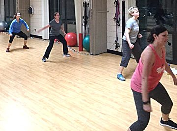 Submitted photo New Ulm Park and Rec fitness instructor Sandy Bromley (far right) leads participants in cardio kickboxing class at 5:45 a.m. on Tuesday mornings.