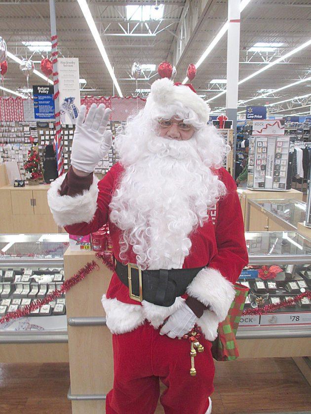 Staff photo by Clay Schuldt  Santa visited Walmart in New Ulm Sunday.